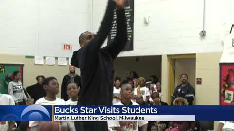 Bucks star Khris Middleton gives new coats to kids at Milwaukee...
